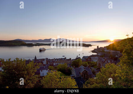 View over Oban Bay from McCaig's Tower, sunset, ferry coming into port, Oban, Argyll and Bute, Scotland, United - Stock Photo