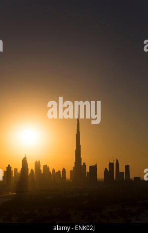 Elevated view of the new Dubai skyline, the Burj Khalifa, modern architecture and skyscrapers on Sheikh Zayed Road, - Stock Photo
