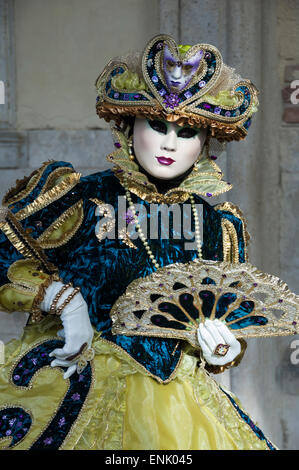 Lady in blue and gold, with fan, Venice Carnival, Venice, Veneto, Italy, Europe - Stock Photo