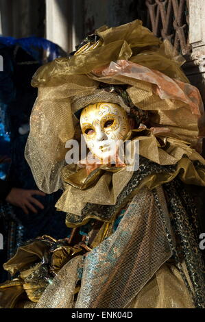 Lady in gold, Venice Carnival, Venice, Veneto, Italy, Europe - Stock Photo