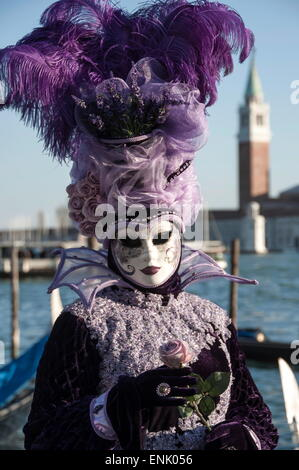 Lady in black and purple mask and feathered hat, Venice Carnival, Venice, UNESCO World Heritage Site, Veneto, Italy, - Stock Photo