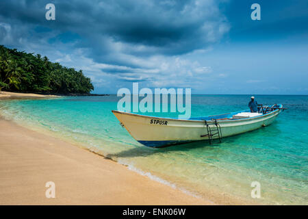 Little motorboat in the turquoise waters of Banana beach, UNESCO Biosphere Reserve, Principe, Sao Tome and Principe - Stock Photo
