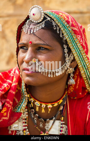 Unidentified Indian woman dressed her traditional scarfs with very nice ornaments and piercings in Jaisalmer,india. - Stock Photo