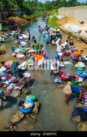 Women washing clothes in a river bed, City of Sao Tome, Sao Tome and Principe, Atlantic Ocean, Africa - Stock Photo