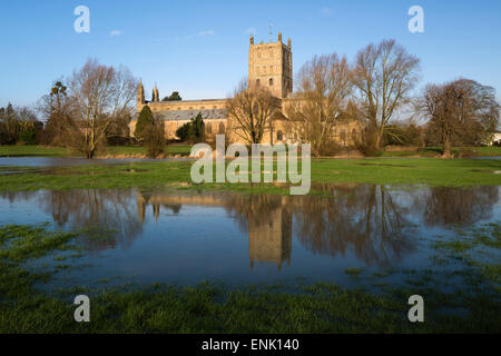 Tewkesbury Abbey reflected in flooded meadow, Tewkesbury, Gloucestershire, England, United Kingdom, Europe - Stock Photo