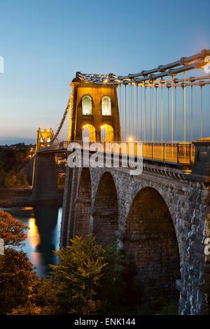 Menai Suspension Bridge at night, built in 1826 by Thomas Telford, Bangor, Gwynedd, Wales, United Kingdom, Europe - Stock Photo