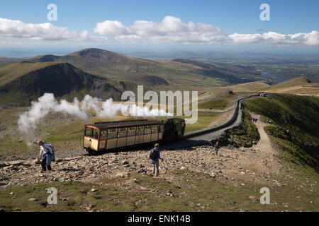 Snowdon Mountain Railway train and the Llanberis path, Snowdon, Snowdonia National Park, Gwynedd, Wales; United - Stock Photo