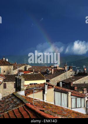 Double rainbow in the sky after the rain. Cortona, Tuscany, Italy - Stock Photo