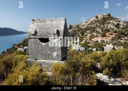 Lycian sarcophagus and castle, Simena (Kalekoy), Kekova, Lycia, Antalya, Mediterranean Coast, Southwest Turkey, - Stock Photo
