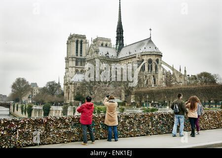 The Love Lock bridge (Pont de l'Archeveche) looking out to Notre Dame, Paris, France, Europe - Stock Photo