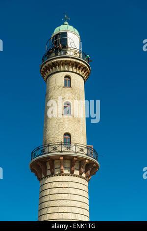 Warnemünde lighthouse (1898) on the estuary of the Warnow River in Warnemünde, Rostock, Germany - Stock Photo