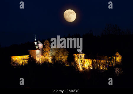 photo composition of Schnellenberg Castle and the moon, Attendorn, Sauerland, North Rhine-Westfalia, Germany - Stock Photo