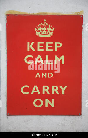 An old  'Keep Calm and Carry On '  sign on a wall in England - Stock Photo