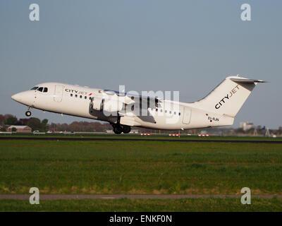 CityJet EI-RJN BAe 146 - Avro RJ takeoff from Polderbaan, Schiphol (AMS - EHAM) at sunset, - Stock Photo