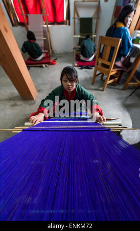 Young woman weaving tapestry at Choki traditional art school Kabesa Thimpu (country capital) Bhutan - Stock Photo