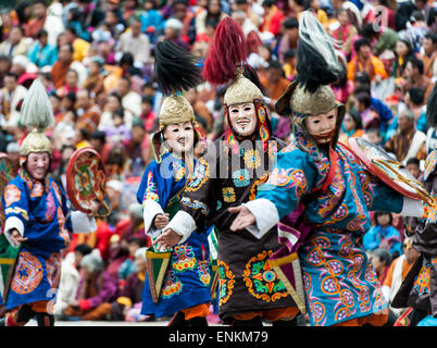 Dancers performing at Paro religious festival Bhutan - Stock Photo