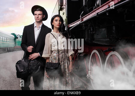 Stylish young couple on vintage railroad station - Stock Photo