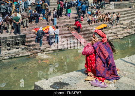 Pashupatinath Temple in Kathmandu, with cremation ghats on the banks of the Bagmati River. - Stock Photo