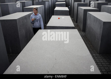 Berlin, Germany. 7th May, 2015. A visitor walks through the Memorial to the Murdered Jews of Europe in Berlin, Germany, - Stock Photo
