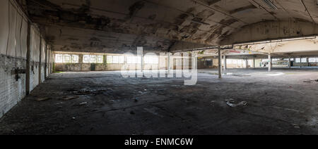 Wide angle panorama of empty derelict warehouse - Stock Photo