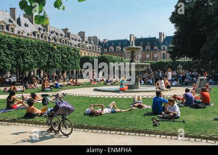 Place des Vosges in summer, Paris, France - Stock Photo