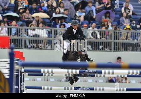 Shanghai, China. 8th May, 2015. MARCO KUTSCHER from Germany, riding Cornets Cristallo during the Table A: Against - Stock Photo