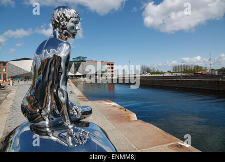 View of the Culture Yard and the underground Danish Maritime Museum to the right behind the sculpture 'Han' or 'He' - Stock Photo
