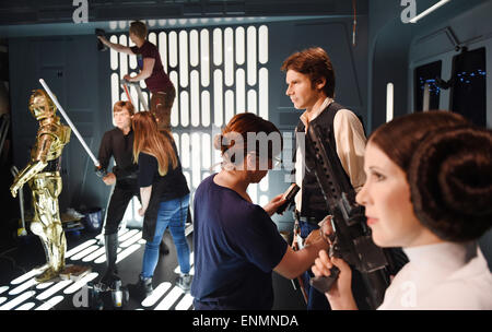 Berlin, Germany. 7th May, 2015. Staff members prepare the wax figures of the Star Wars saga in preparation for the - Stock Photo