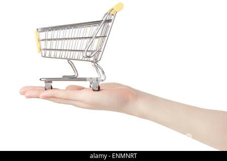 Woman hand holding shopping cart - Stock Photo