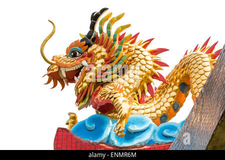 Dragon statue on temple roof on isolated background - Stock Photo