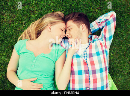 smiling couple in park - Stock Photo