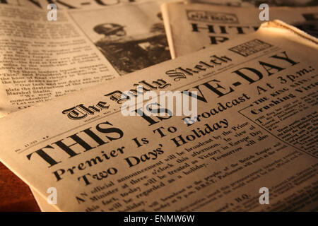 Normandy, France, 8th May 2015. Old copies of WWII newspapers including the announcement of Victory in Europe day - Stock Photo