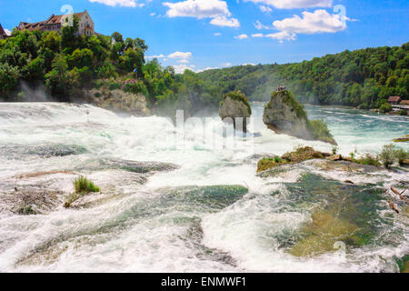 Rheinfall - biggest waterfall in Europe, located in Schaffhausen, Switzerland. Two massive rock in the middle of - Stock Photo