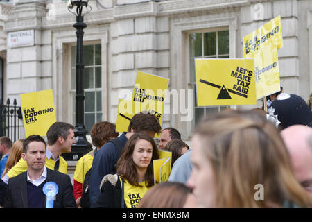 Downing Street, London, UK. 8th May 2015. An anti Tax dodging protest takes place outside Downing Street as the - Stock Photo