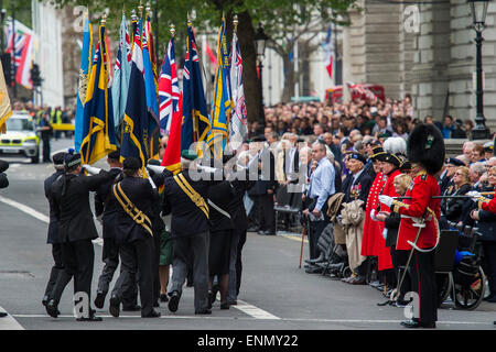 London, UK. 8th May, 2015. British Legion flag bearers march off and are saluteed by veterans after the memorial - Stock Photo