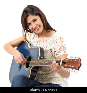Musician woman playing guitar in a course isolated on a white background - Stock Photo