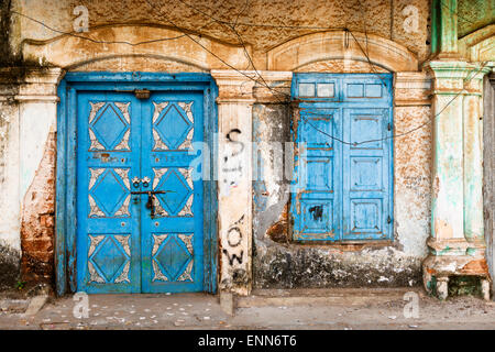 An old ornate blue door and window in the colonial Old Town of Fort Kochi. - Stock Photo
