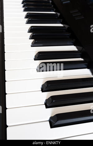 side view of black and white keyboard of digital piano close up - Stock Photo