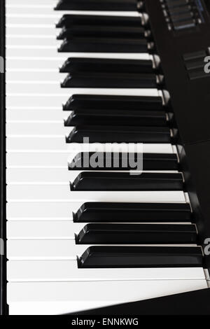 side view of black and white keys of digital piano close up - Stock Photo