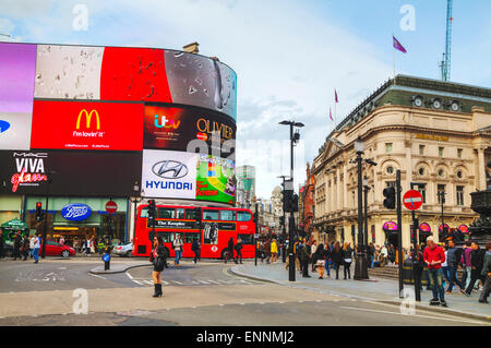 LONDON - APRIL 12: Piccadilly Circus junction crowded by people on April 12, 2015 in London, UK. - Stock Photo