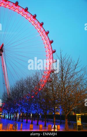 LONDON - APRIL5: The London Eye Ferris wheel in the evening on April 5, 2015 in London, UK. - Stock Photo