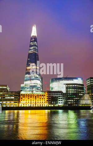 LONDON - APRIL 4: Overview of London with the Shard of Glass on April 4, 2015 in London, UK. Standing 306 metres - Stock Photo