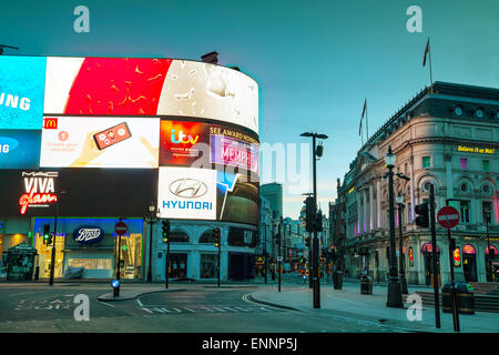 LONDON - APRIL 12: Piccadilly Circus junction early in the morning on April 12, 2015 in London, UK. - Stock Photo