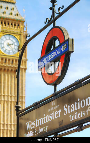LONDON - APRIL 12: London underground sign at the Westminster station on April 12, 2015 in London, UK. - Stock Photo