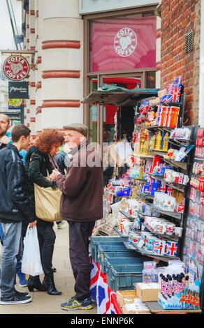 LONDON - APRIL 13: Street souvenir shop with tourists on April 13, 2015 in London, UK. London is a popular centre - Stock Photo