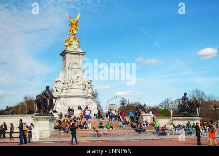 LONDON - APRIL 12: Queen Victoria memorial monument in front of the Buckingham palace on April 12, 2015 in London, - Stock Photo