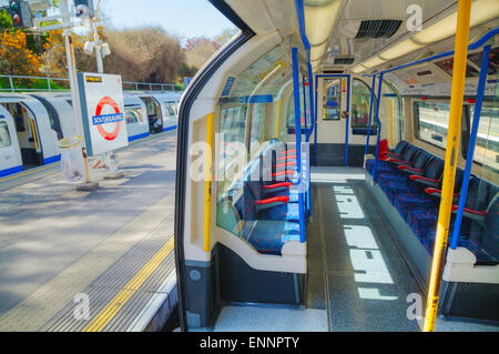 LONDON - APRIL 15: Interior of the underground train car on April 15, 2015 in London, UK. The system serves 270 - Stock Photo