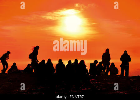 Portugal, Algarve: Tourists watching scenic sunset at Cape St. Vincent - Stock Photo