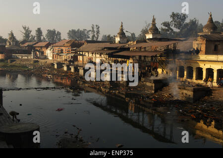Pashupatinath Temple complex on the sacred Bagmati River is where hindu cremations take place in Kathmandu. - Stock Photo