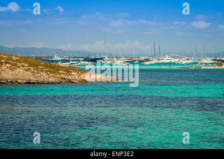 Luxury yachts in turquoise beach of Formentera Illetes - Stock Photo